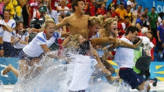 Tom Daley and his team dive into the pool to celebrate.