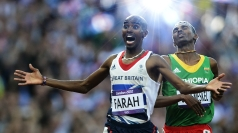 Mo Farah celebrates as he crosses the line in the 5,000m.