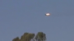 Amateur footage shows plane on fire in sky above Syria