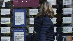 A woman looks at job adverts in London.