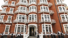 Police guard the Ecuadorian embassy in London.