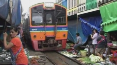 Train passes through Thai market