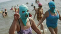 Chinese women wear facekinis on the beach