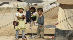 Syrian children play at a Turkish refugee camp.