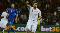 Frank Lampard celebrate scoring a penalty against Moldova.