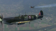 Jetman flies in formation with a Spitfire.