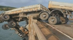 Truck hangs over bridge in Brazil