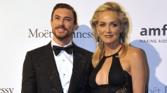 Sharon Stone shows off toyboy a day after hospital treatment