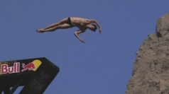 Competitors in huge cliff diving tournament in Oman.