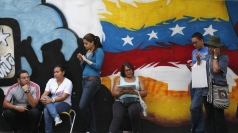 Venezuelans line up before casting their vote