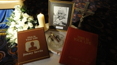 A tribute is seen next to the coffin of Jimmy Savile
