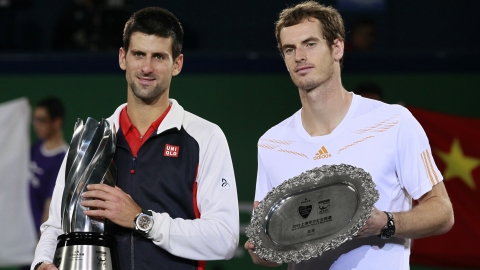 Djokovic stands next to Murray during trophy presentation.