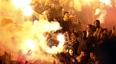 Serbian fans holding up flares during the England U21 match.