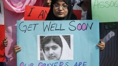 Malala Yousafzai stands up in hospital.