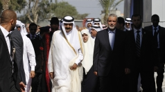 Qatar's emir makes a landmark Gaza Strip visit to see Hamas.