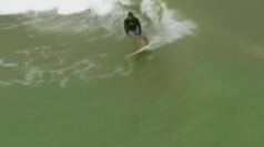 Surfers ride the big waves from Hurricane Sandy