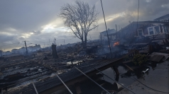 Homes devastated by fire and Hurricane Sandy