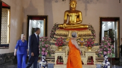Obama and Clinton visit a temple.