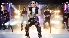 Its video features the cuddly Psy's 'horse dance'.
