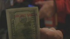 Secret santa gives out $100 bills to Hurricane Sandy victims
