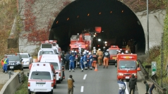 Firefighters gather in front of the Sasago Tunnel