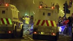 Officer injured after violence flared in Belfast.