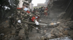Woman killed in China building collapse