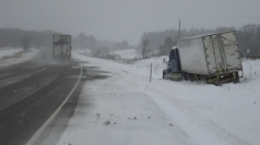 Vehicles career off roads as blizzards hit the US