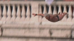 Extreme diving from bridge over Rome's Tiber river