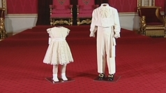 Coronation outfits on display at Buckingham Palace