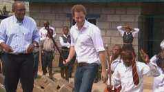 Prince Harry dancing with children on Africa charity visit