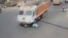 Dramatic crash: Trucks runs over woman on scooter