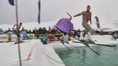 Fancy dress skiers plunge into cold water at Red Bull event.