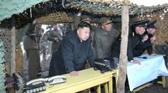 Kim Jong-un watches anti-landing drills.