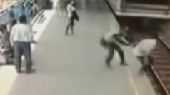 Dramatic CCTV rescue: Officer pulls man from path of train