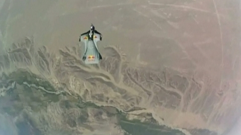 Skydivers fly over Peru Nazca lines