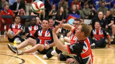 Prince Harry plays sitting volleyball with injured troops