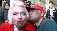 Richard Branson turns air hostess after losing bet