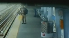 CCTV of baby in pram falling onto train tracks