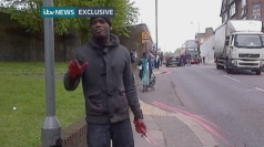 Man with blood on hands holds knife at Woolwich attack scene