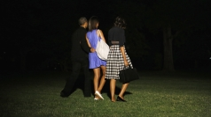 Obama family leave on Air Force One for G8 summit