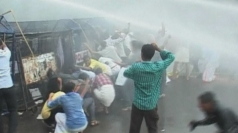 Police in India use water cannons and tear gas on protesters