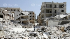 A district of Aleppo lies asunder after a bombing attack.