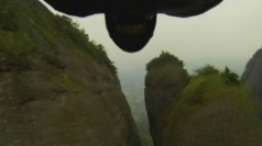 Wingman flies through 4m-wide valley in China... at 160KPH