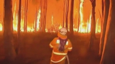 Australia firefighters faced with 30m high flames