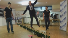 Guinness World Records: Most upright bottles walked across