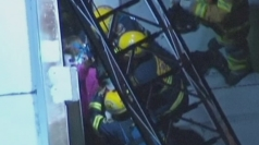 Woman trapped in gap between buildings in US