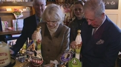 Prince Charles pulls pints behind a bar in Essex