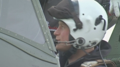Prince Harry climbs into a Spitfire at Goodwood