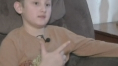 Boy who pretended finger was gun suspended